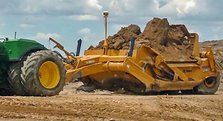 Scraper Excavating Dirt from Commercial Development Site